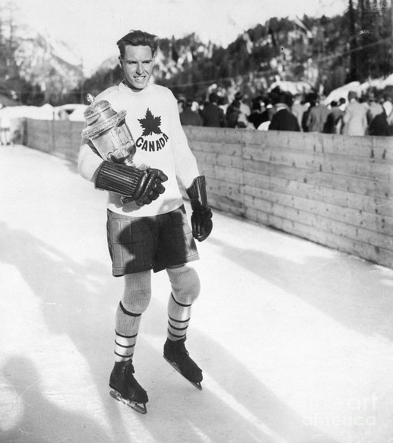 Canadian Hockey Captain With Olympic Photograph by Bettmann