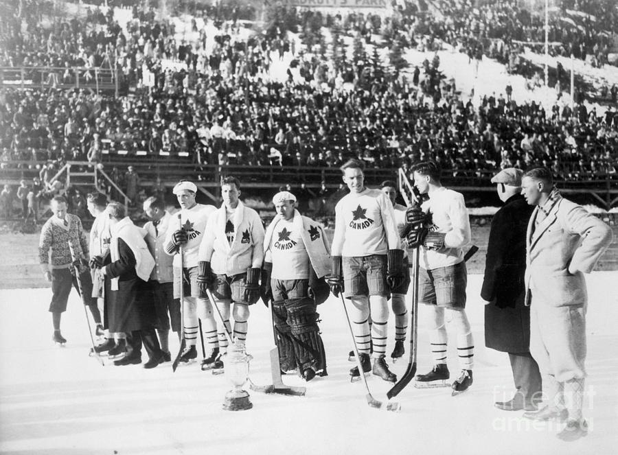 Canadian Hockey Team With Olympic Cup Photograph by Bettmann