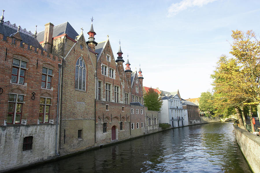 Canal In The Old Town Of Brugge Photograph by Christof Koepsel