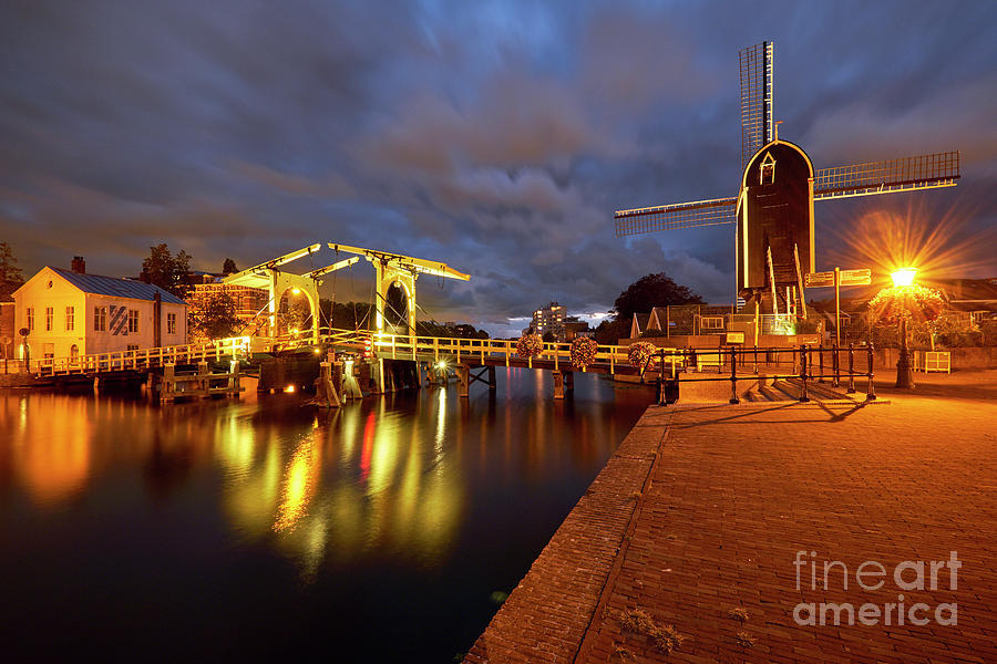 Canal with a Small Bridge and Windmill at Night by George Oze