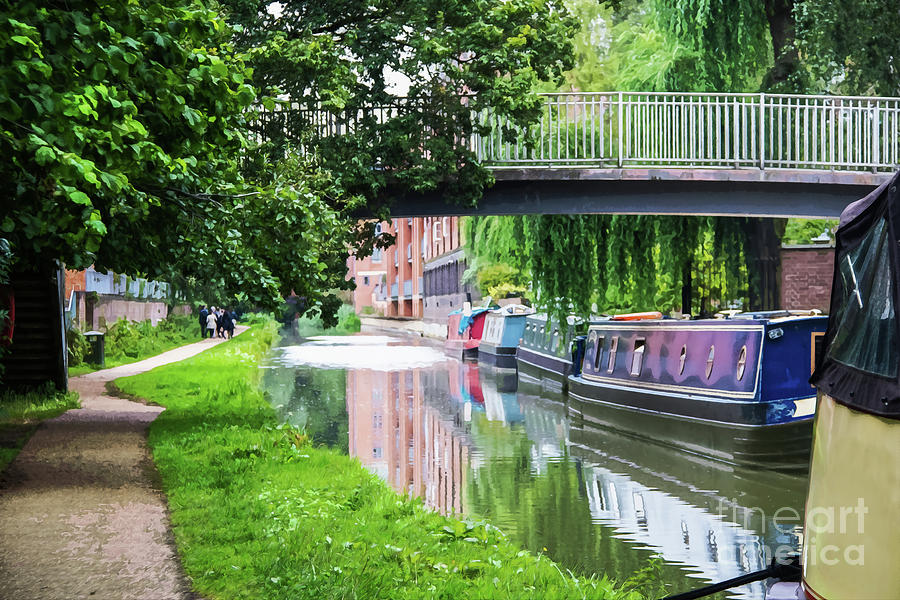 Canal with boats tied up under bridge and reflections in water near Oxford England  by Susan Vineyard