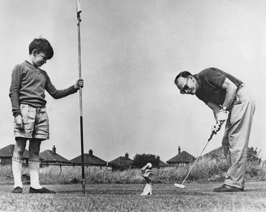 Candid Camera Golf Stunt Photograph by Express