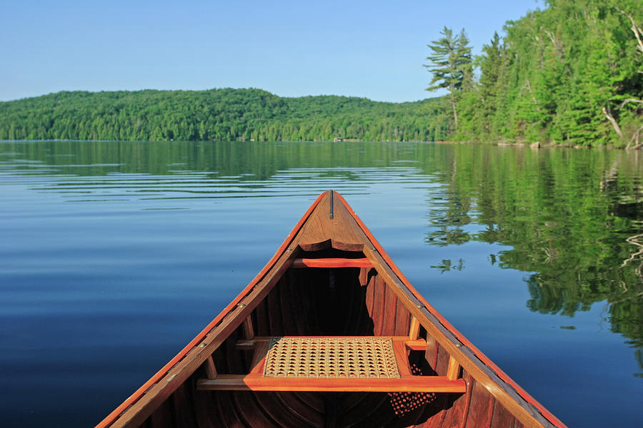 Canoe In The Morning Sun Photograph by Huntimages