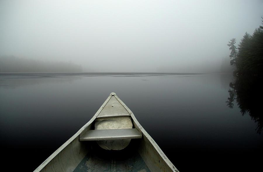 Canoe On A Misty Lake Photograph by Birdseye