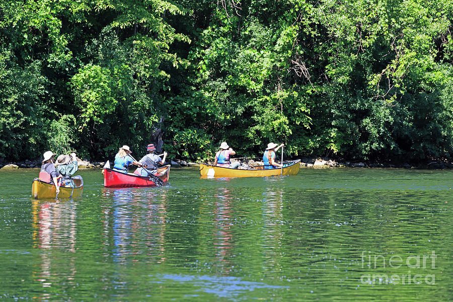 Canoes Photograph - Canoeing On The Rideau Canal In Newboro Channel Ontario Canada by Louise Heusinkveld