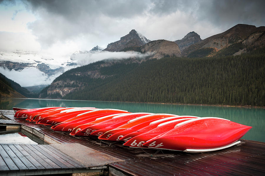 Canoes On The Dock Photograph by Pgiam
