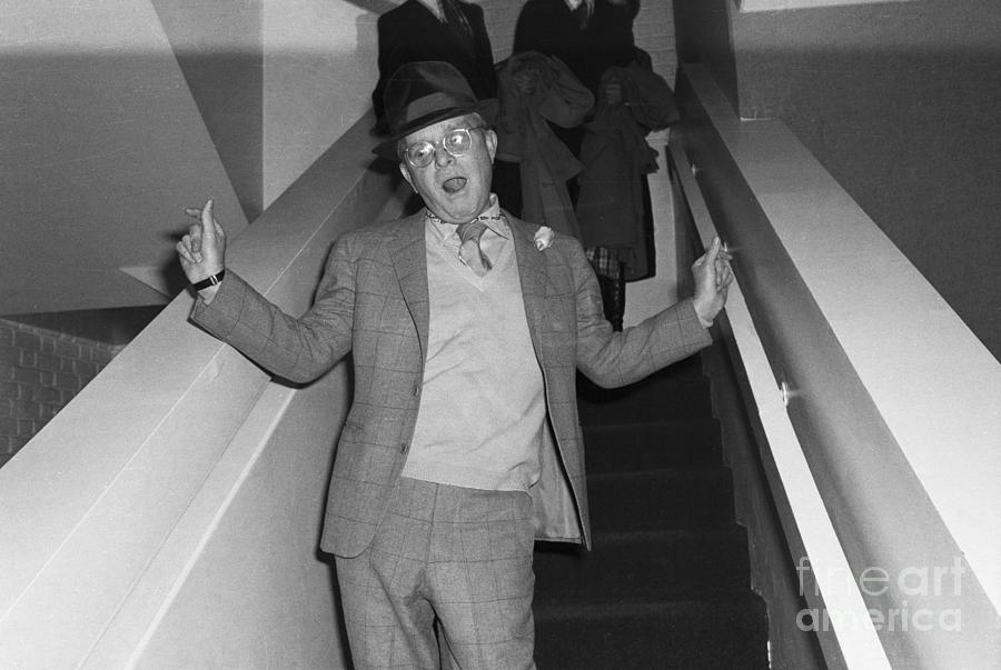 Capote On Stairs Wavingwaist Up 1978 Photograph by Bettmann