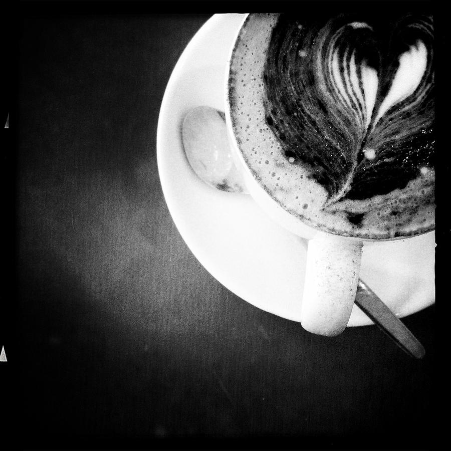 Cappuccino With Foam Art On Saucer With Photograph by Librarymook