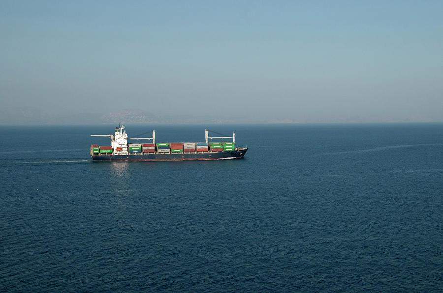 Cargo Ship At Sea Photograph by Mitch Diamond