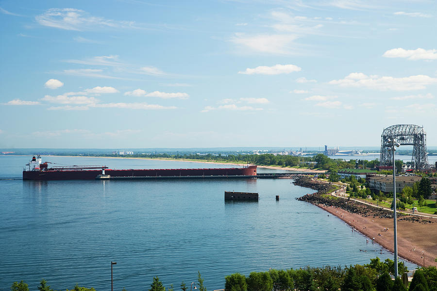 Cargo Ship Entering Harbor In Duluth Photograph by Jimkruger