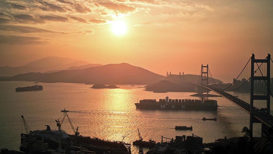 Cargo Vessel Crossing The Bridge Photograph by Jimmy Ll Tsang