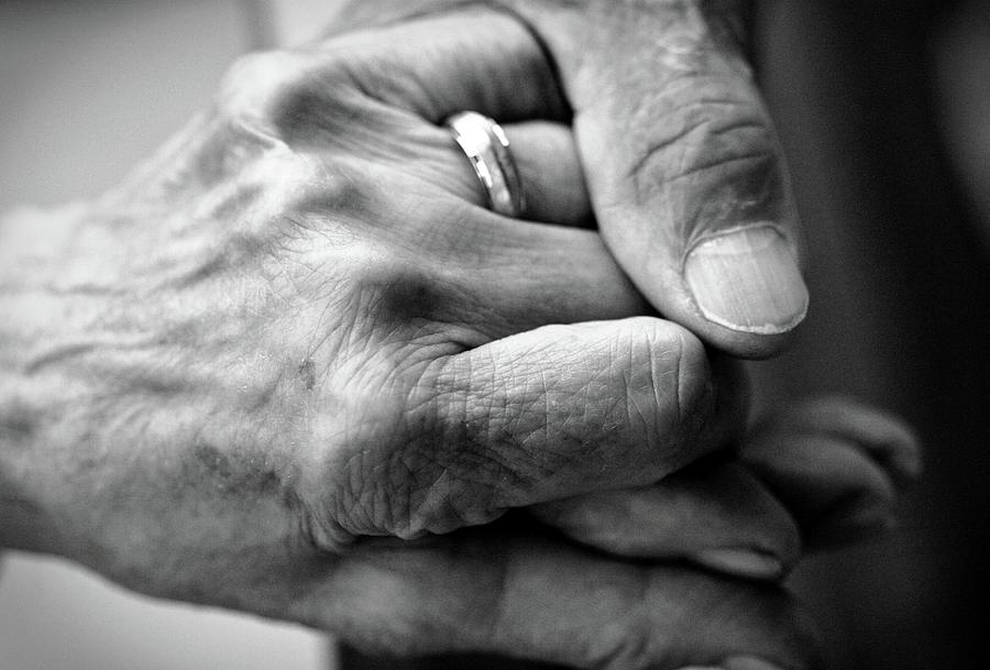 Caring Hand On Senior Hand Photograph by Steven Brisson Photography