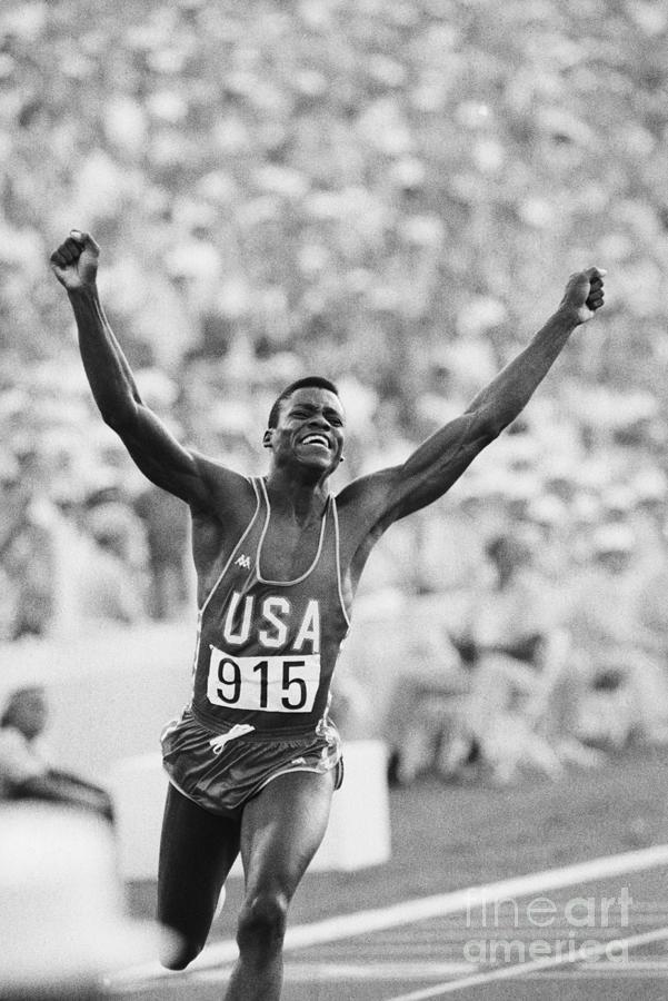 Carl Lewis Winning Gold Medal Photograph by Bettmann