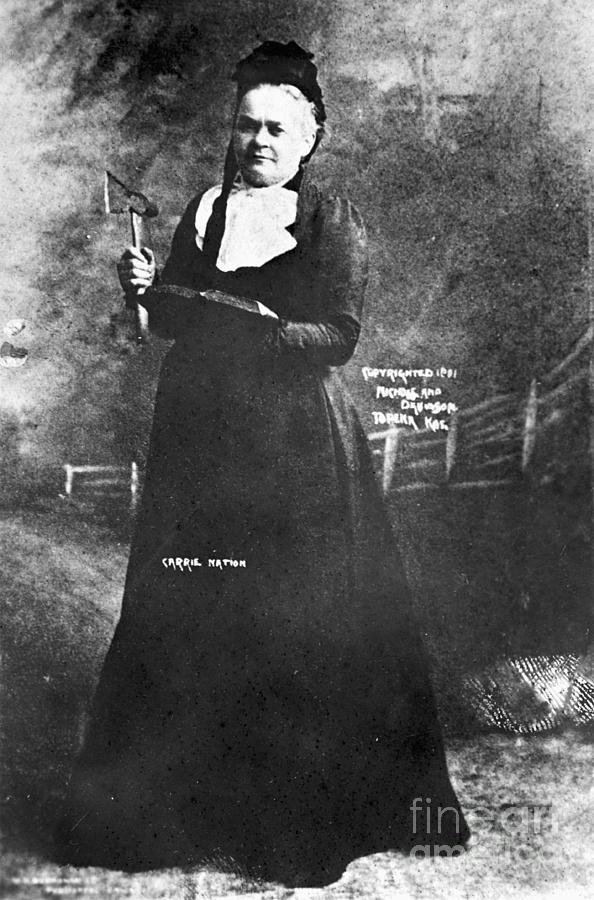 Carrie Nation With Bible And Hatchet Photograph by Bettmann
