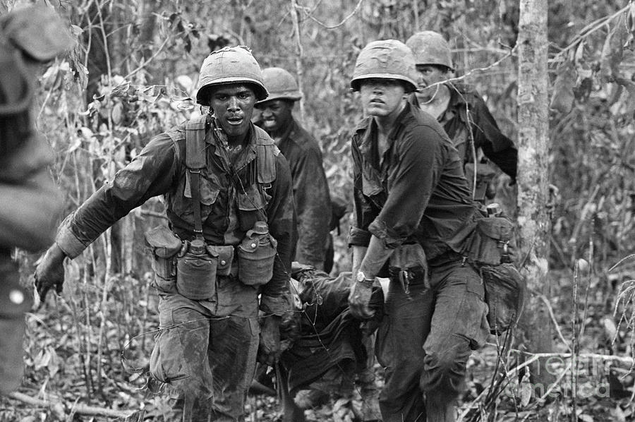 Carrying Wounded Comrade Photograph by Bettmann