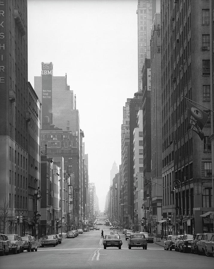 Cars Riding On Street Of American City Photograph by George Marks