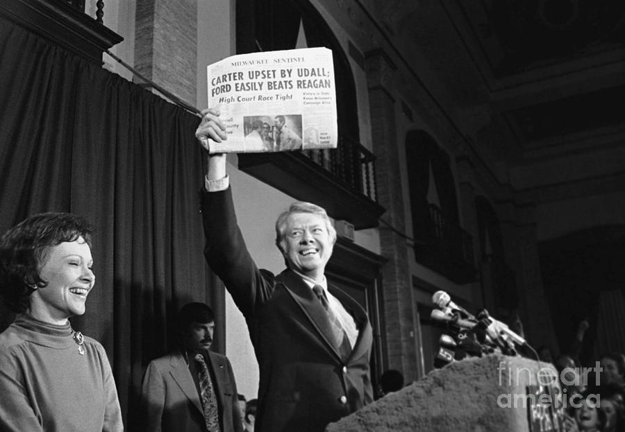 Carter Holds An Incorrect Newspaper Photograph by Bettmann