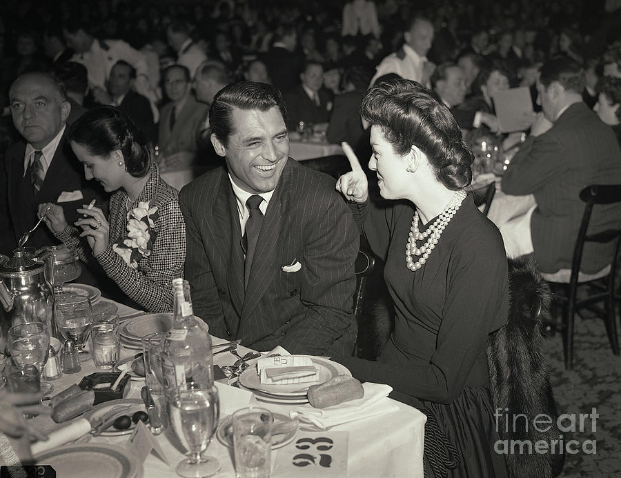 Cary Grant And Rosalind Russell Photograph by Bettmann