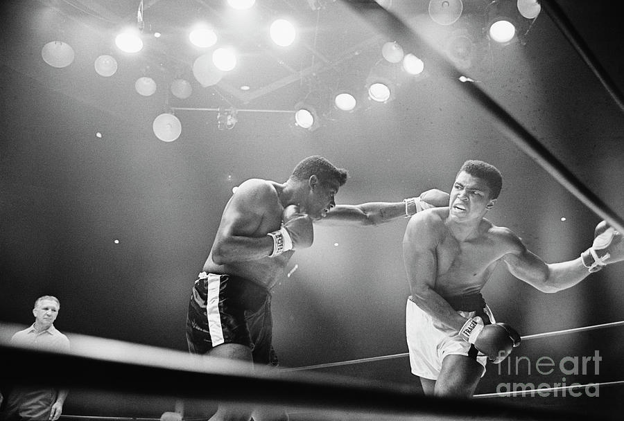 Cassius Clay Snarling At Floyd Patterson Photograph by Bettmann