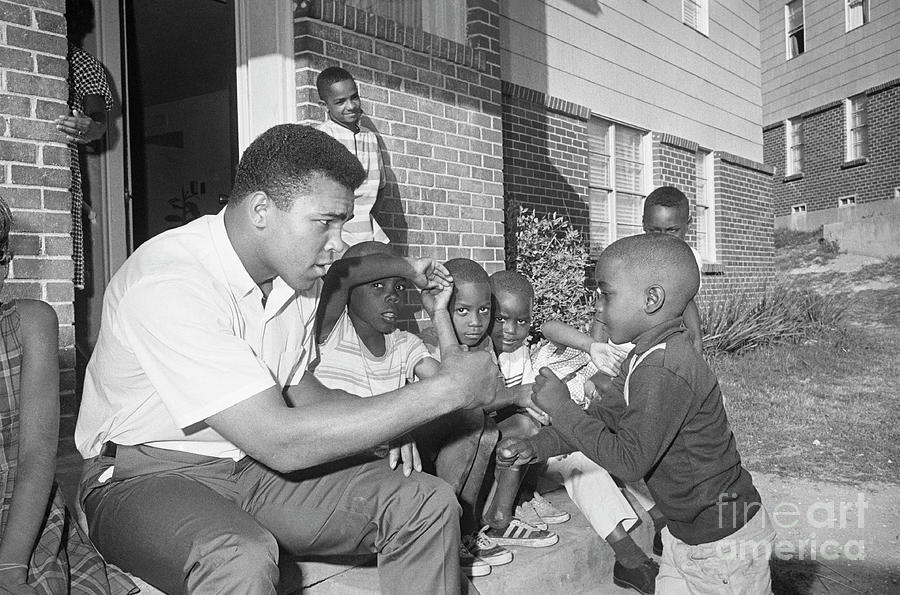 Cassius Clay Sparring With Young Boy Photograph by Bettmann
