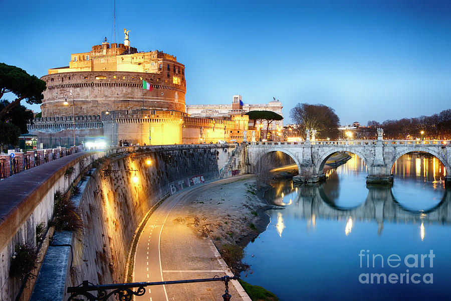 Castle Of The Holy Angel Lit Up at Dusk by George Oze