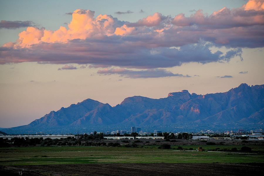 Catalina Mountains and downtown Tucson evening clouds  by Chance Kafka