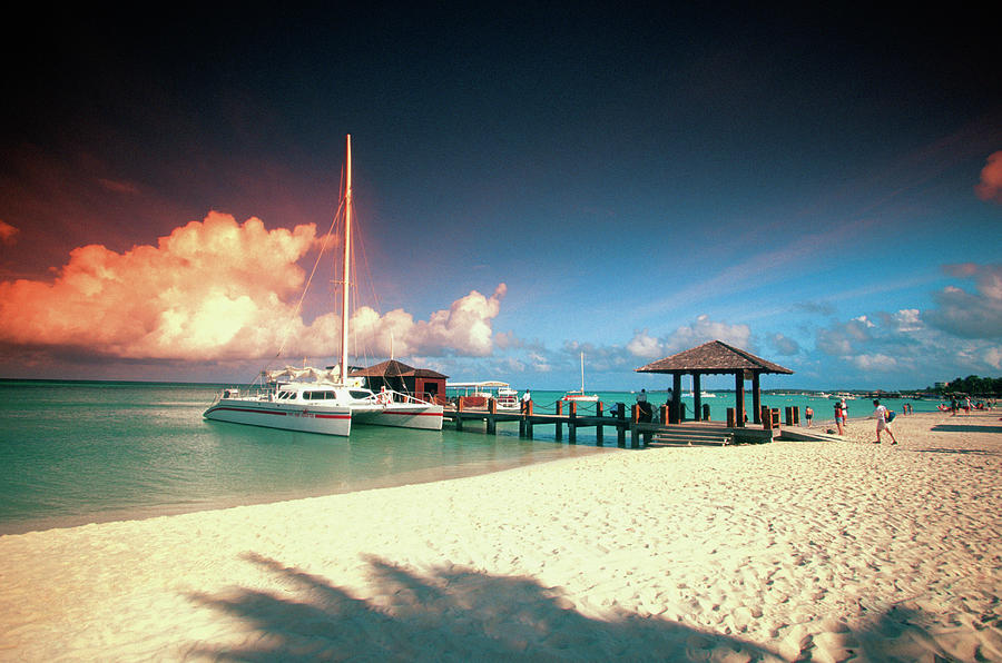 Catamaran Docked At Pier At Sunset On Photograph by Medioimages/photodisc