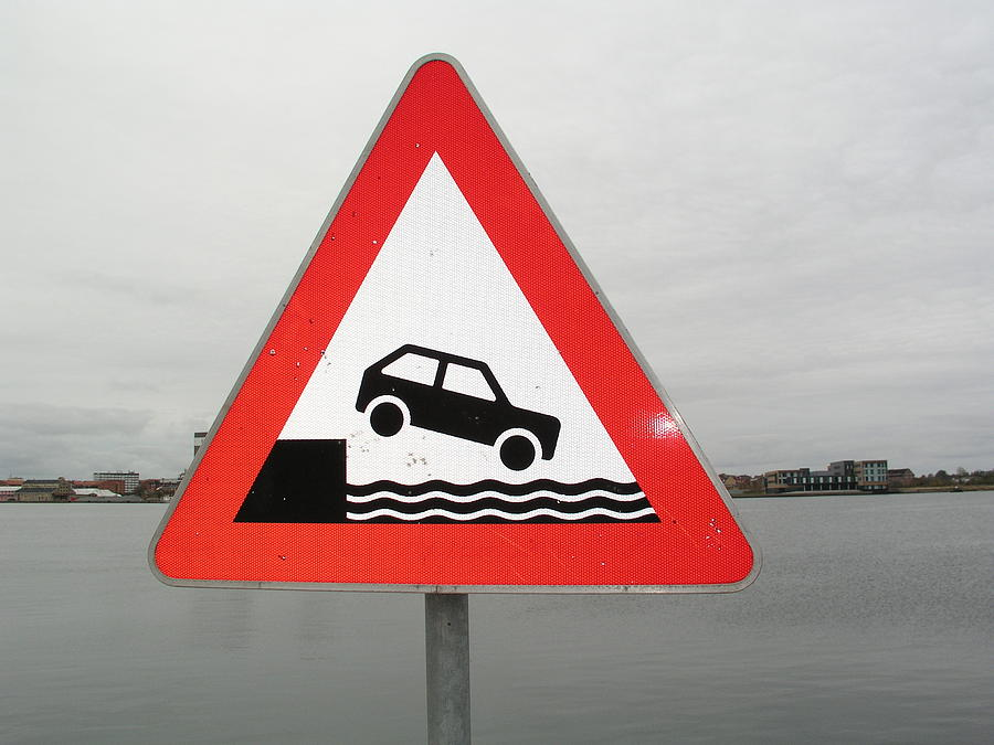 Caution Sign At Harbor Photograph by Simon Wedege