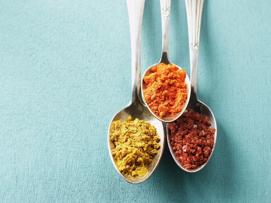 Cayenne Pepper, Curry Powder And Rock Photograph by Westend61