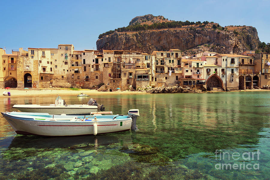 Cefalu Photograph - Cefalu old town and harbor with city beach and clear sea in Sicily by IPics Photography