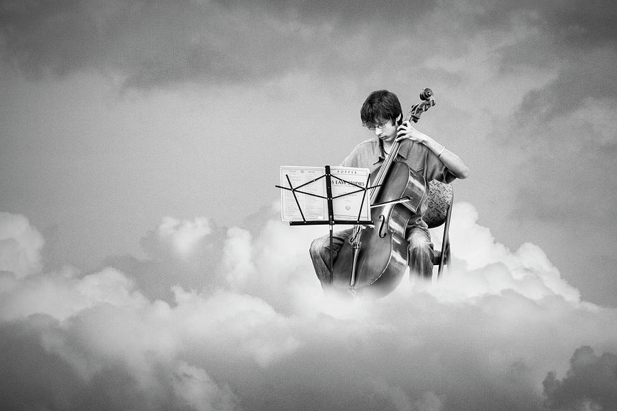 Cello Player Playing on Cloud Nine in Black and White by Randall Nyhof