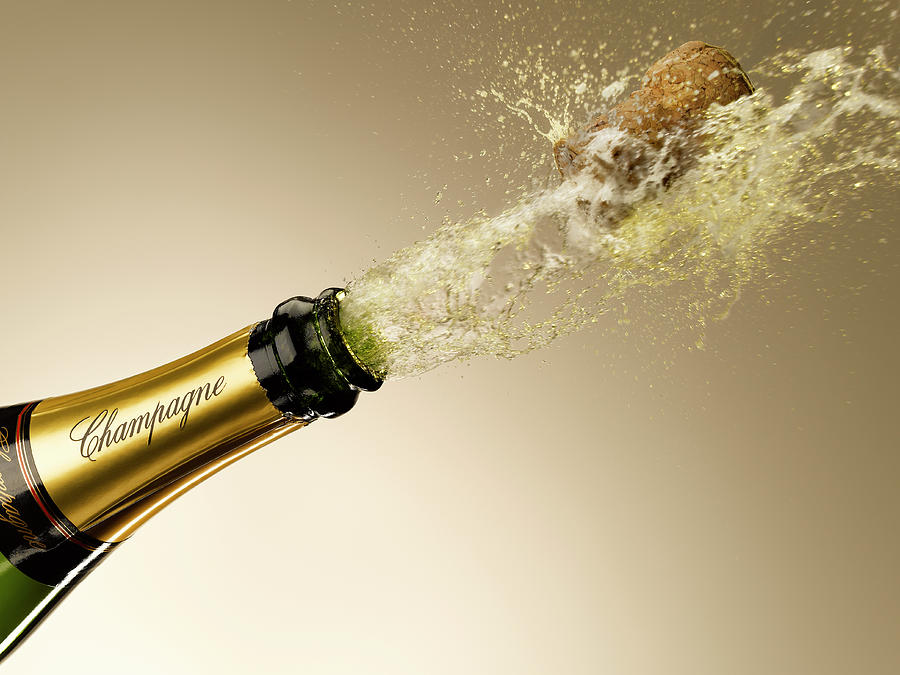 Champagne And Cork Exploding From Bottle Photograph by Andy Roberts