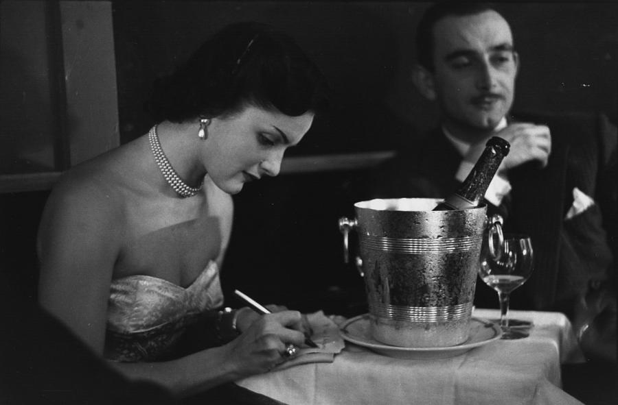 Champagne On Table Photograph by Kurt Hutton