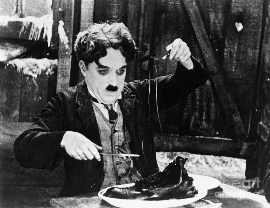 Charlie Chaplin In The Shoe-eating Photograph by Bettmann