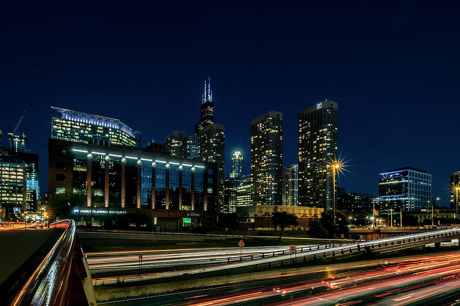 Chicago's Kennedy expressway and Willis Tower at dusk  by Sven Brogren