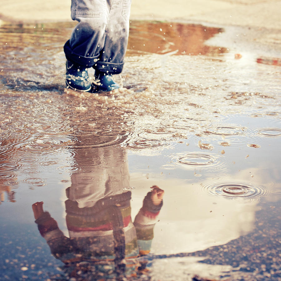 Child In A Puddle Photograph by Vpopovic