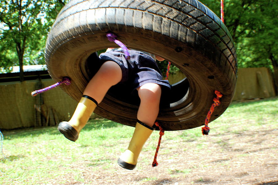 Child In Boots Swinging On A Tire Swing Photograph by Meredith Winn Photography