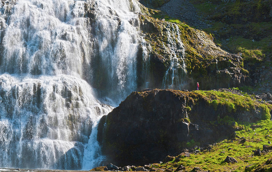 Child Looking At Huge Waterfall Iceland Photograph by Fotovoyager