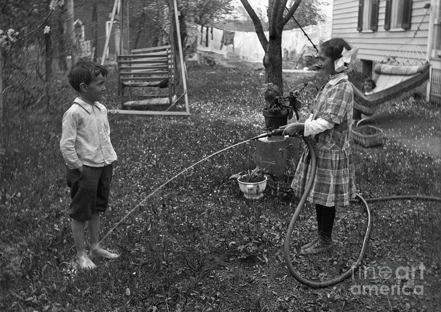Children 6-7 Years Playing With Hose Photograph by Bettmann