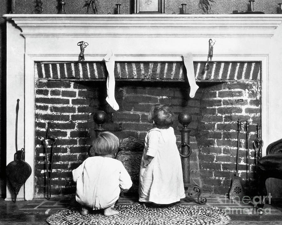 Children At Fireplace Waiting For Santa Photograph by Bettmann