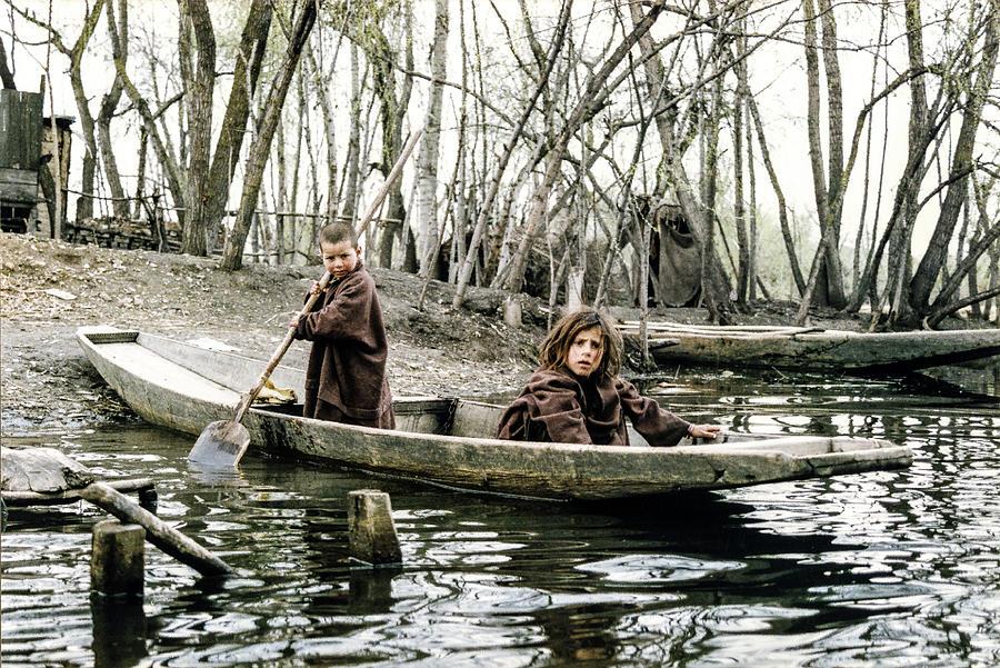 Children in Boat on Dal Lake, Kashmir by Pete Hendley