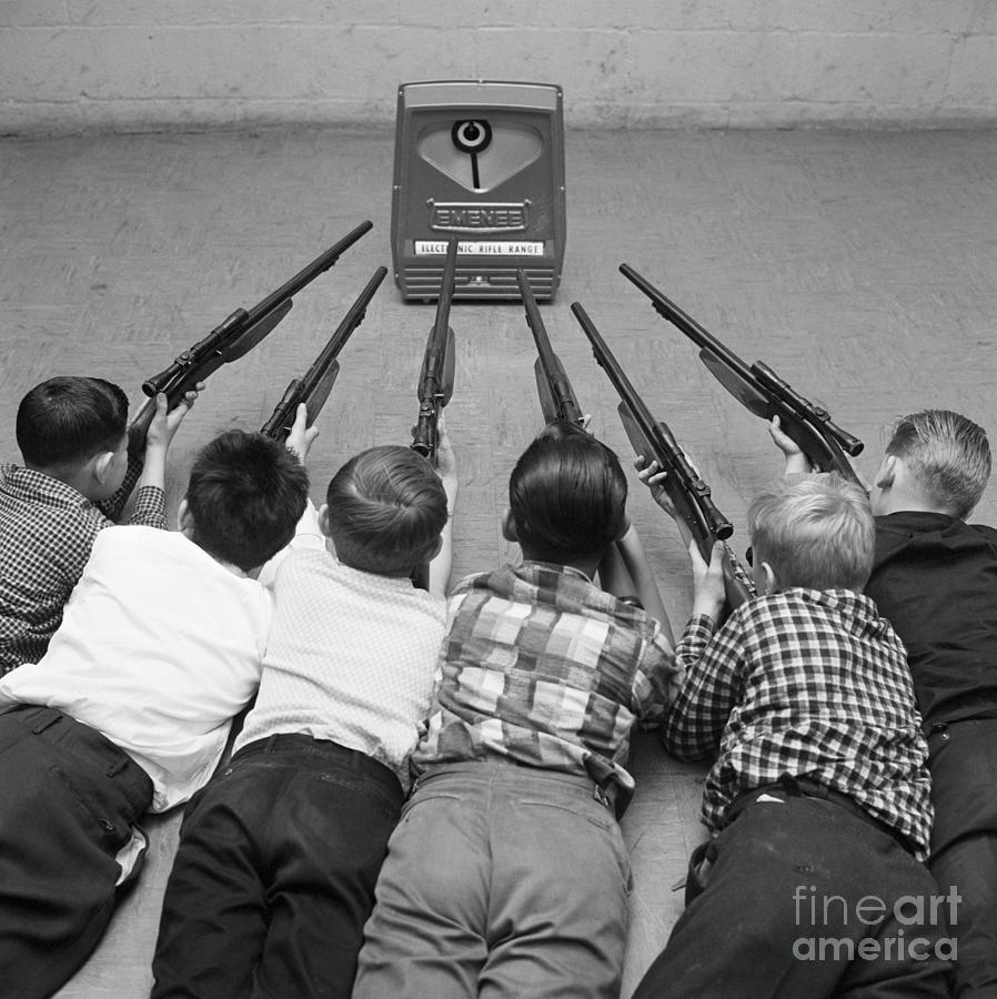 Children Playing With Toy Gun Set Photograph by Bettmann