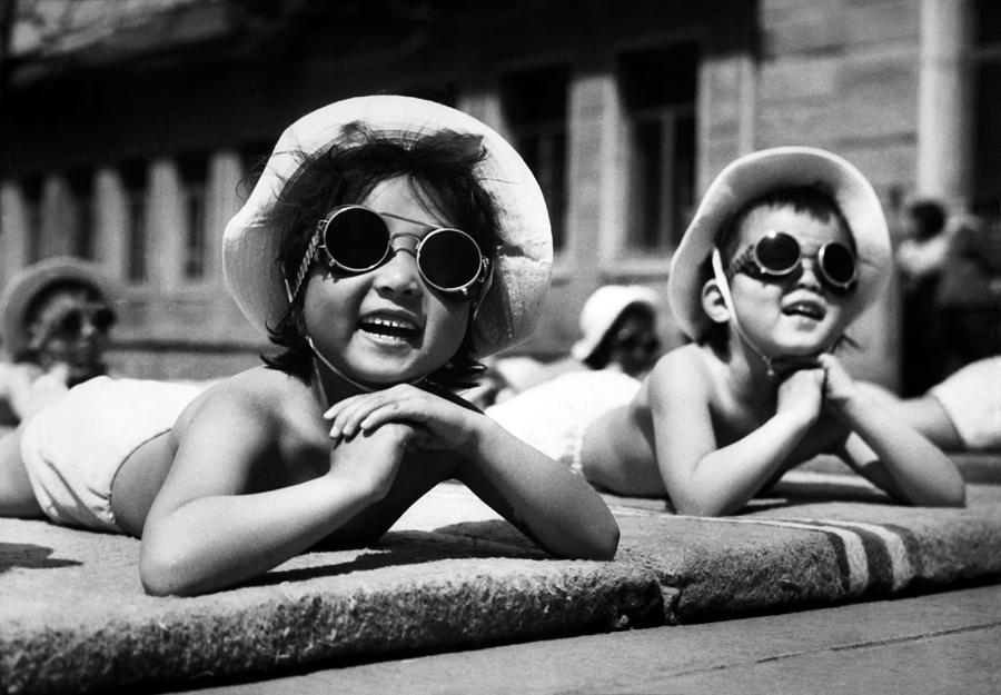 Children Taking A Sunbath Photograph by Keystone-france