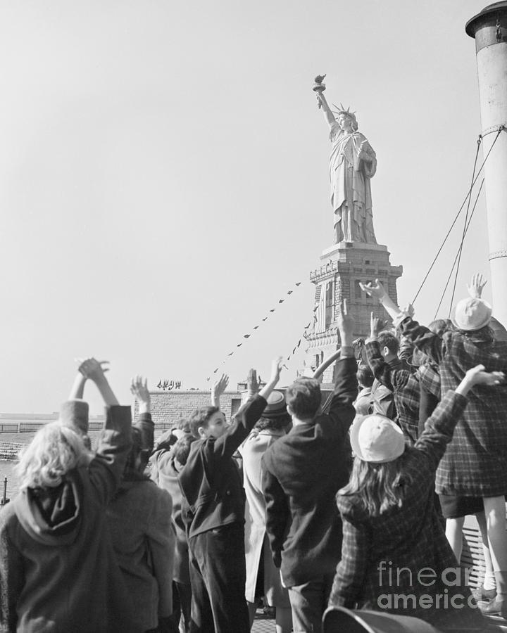 Children Waving To Statue Of Liberty Photograph by Bettmann