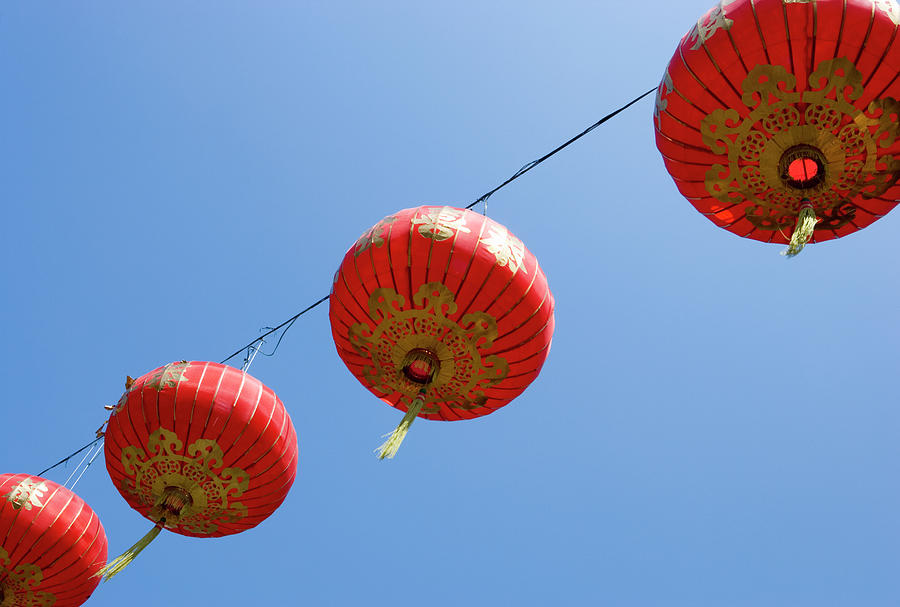 Chinese Lanterns Against Blue Sky Photograph by Stephen Studd