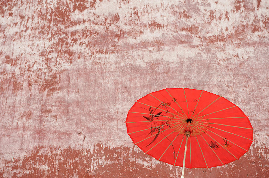 Chinese Parasol Against A Textured Wall Photograph by Shanna Baker