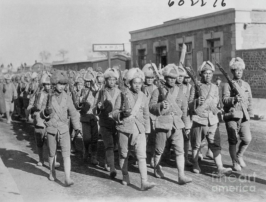 Chinese Soldiers Marching With Weapons Photograph by Bettmann