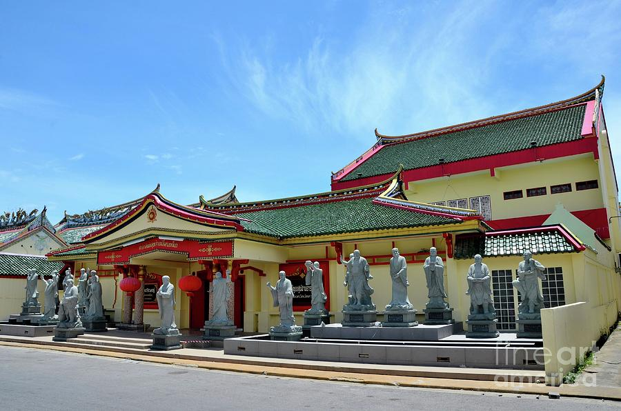Chinese temple building with statues of gods and wood door Pattani Thailand by Imran Ahmed