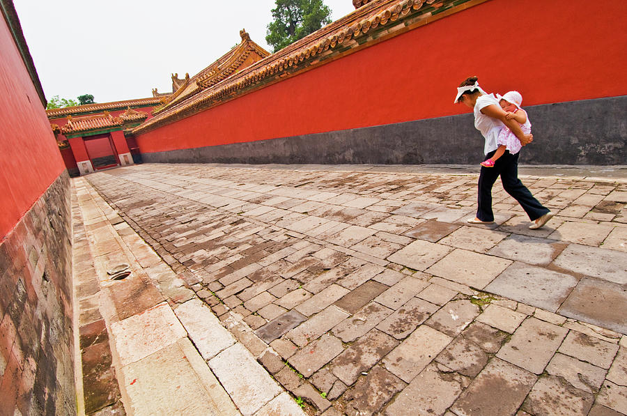 Chinese Tourist Woman Carrying Child Photograph by Tim Makins