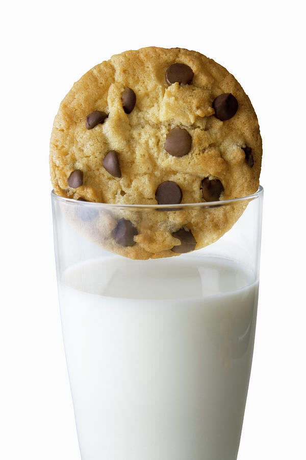 Chocolate Chip Cookie And Glass Of Milk Photograph by Burazin